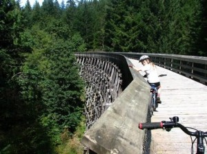 child on bike on bridge photo