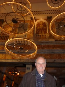David Orr in London. Note highly energy wasteful chandeliers behind him (referred to in the interview)