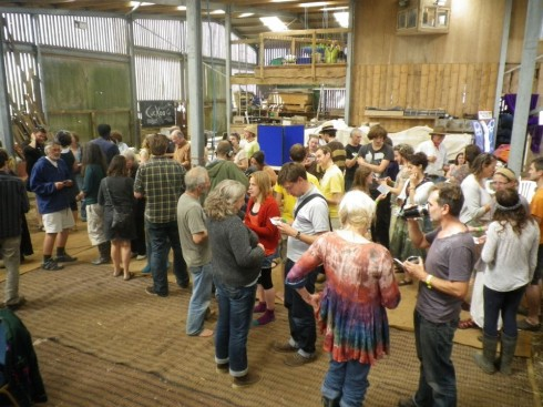 people in a barn at sunrise off grid festival